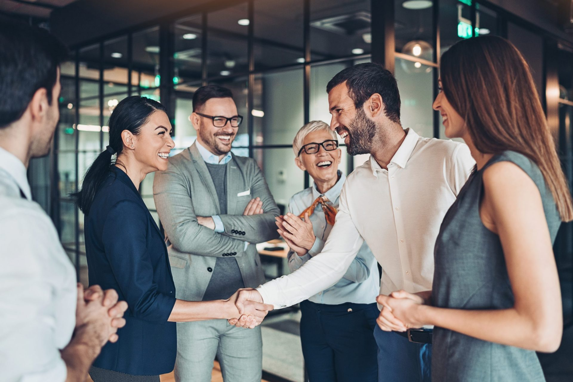 Group of business persons handshake in the office